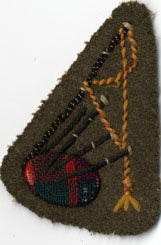 The special C.W.A.C. Piper's Sleeve-Badge